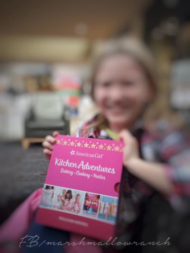 A little girl shares her Christmas gift...a baking set from Williams-Sonoma.