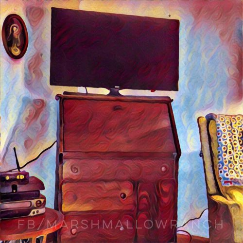 Prisma app photo of drop leaf desk and television.