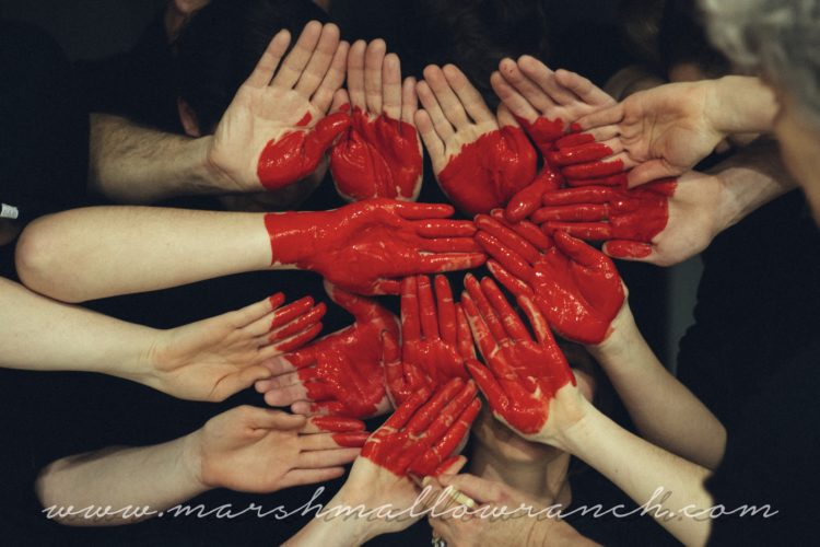 Heart painted on hands