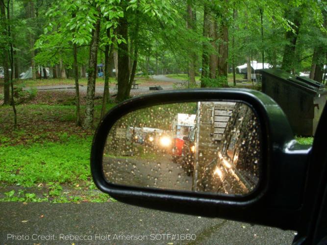 Camper Caravan in the rear view mirror