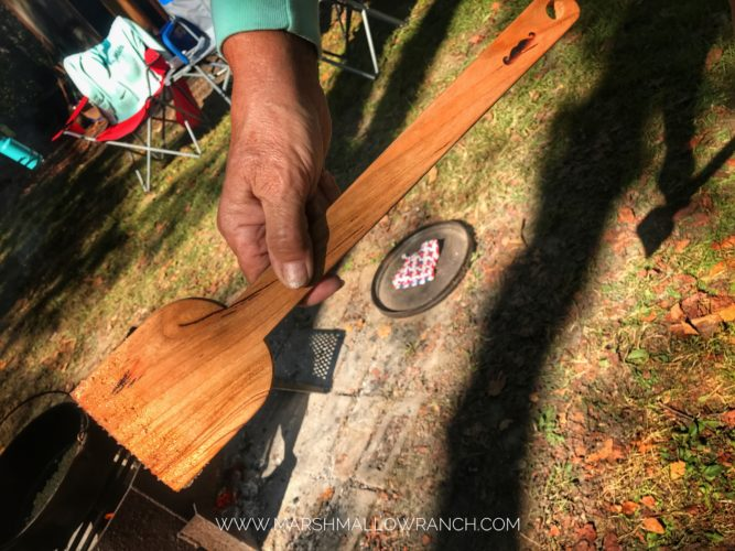 Wooden paddle for stirring in a Dutch oven
