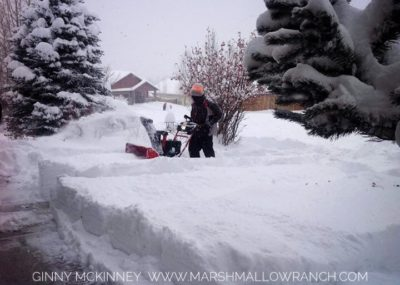 Man operating snowblower