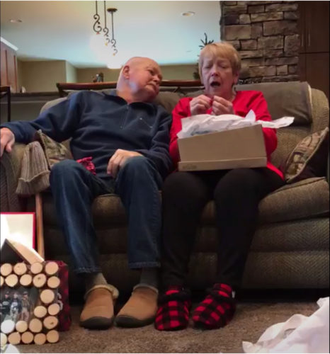 Couple opening gifts