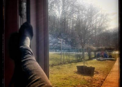 Woman sitting in late winter sun